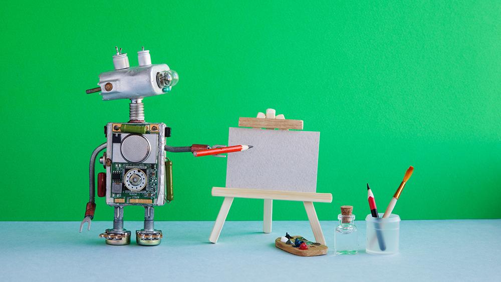 ロボットが鉛筆で何かを書こうとしている